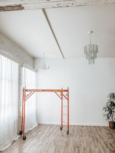 corner of photography studio white wall chandeliers